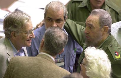 Cuban President Fidel Castro, right, talks with an American intellectual and linguist Noam Chomsky, left, before the start of the Latin American Council of Social Sciences conference in Havana, Cuba, Tuesday October 28, 2003. At center, between  Castro and Chomsky Cuban writer Carlos Marti looks on. (AP Photo/Cristobal Herrera)
